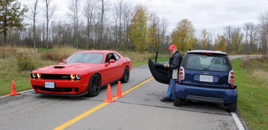 """An Automotive Journalist is at the ready to evaluate a Dodge Challenger in the Sports/Performance over 50k category, on a course set up for """"real world"""" back to back testing at """"Test Fest"""" in Niagara Falls on Wednesday, October 22nd"""